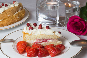 A slice of fresh strawberry and elderflower cake