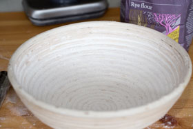 A proving basket sprinkled with rye flour