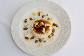 Panna cotta with cloudberry jam, roasted pistachio nuts and white chocolate