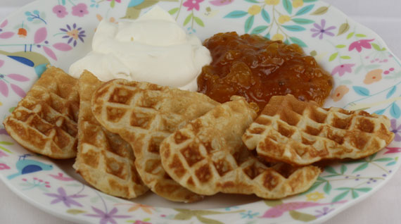 Waffles with cloudberry jam and whipped cream