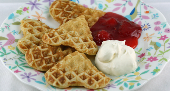 Swedish egg waffles with lightly whipped cream and strawberry jam