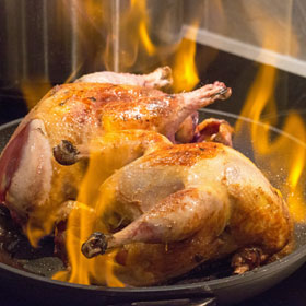 Flambeing pheasant for Sunday lunch