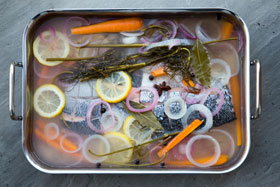 Cold poached salmon in its marinade