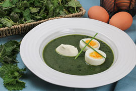 Nettle soup with hard boiled eggs and creme fraiche